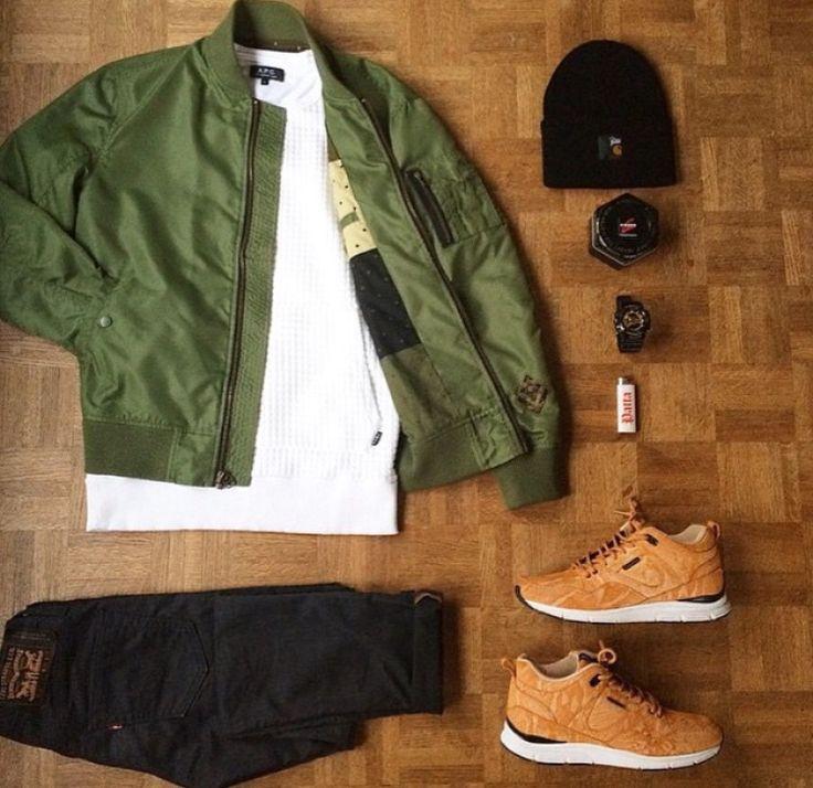 olive bomber. white crewneck sweatshirt. black jeans. tan leather sneakers. black beanie.