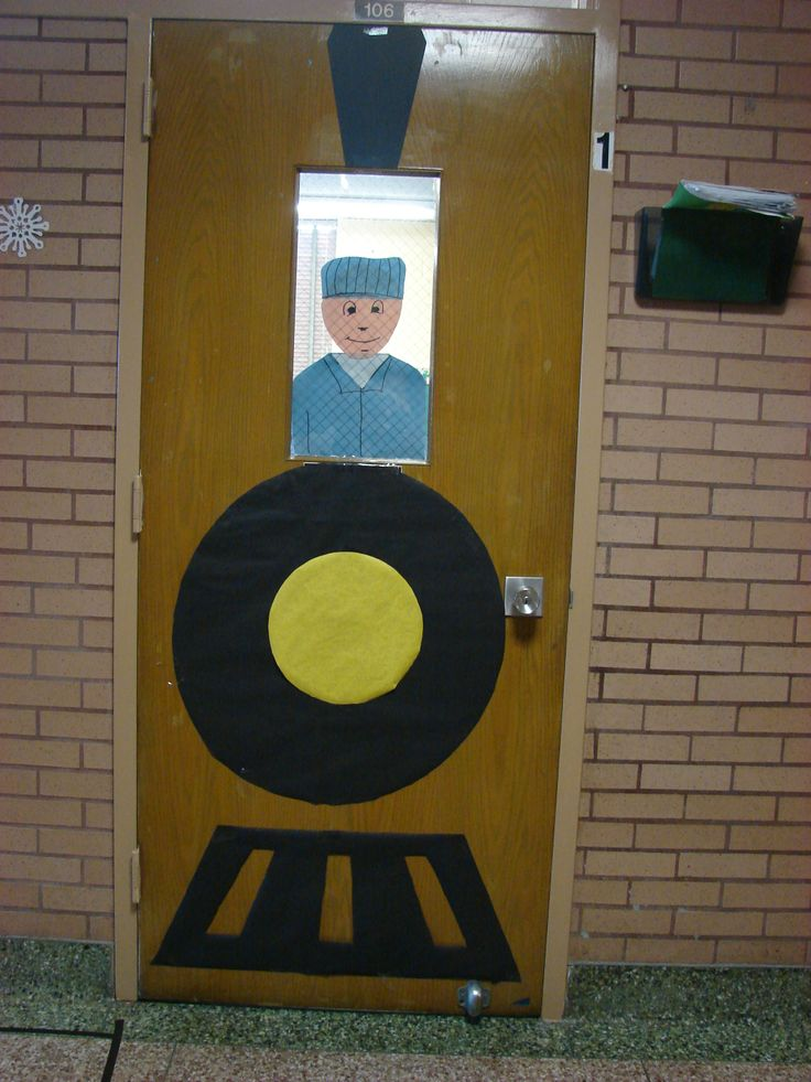 "classroom door-- with song ""Happily we go along, learning letters singing songs, happily we go along on the alphabet train"""