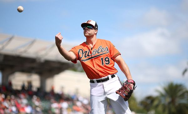 Chris Davis Photos Photos - Chris Davis #19 of the Baltimore Orioles tosses a ball to the fan after the third inning of the Spring Training Game against the Tampa Bay Rays on March 14, 2017 at Ed Smith Stadium in Sarasota, Florida. Tampa Bay defeated Baltimore 9-6. - Tampa Bay Rays v Baltimore Orioles