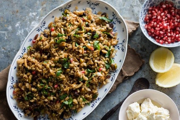 Fresh pomegranate seeds and pomegranate molasses play a starring role in this Persian rice dish. Slivered almonds and pistachios give it wonderful texture too.