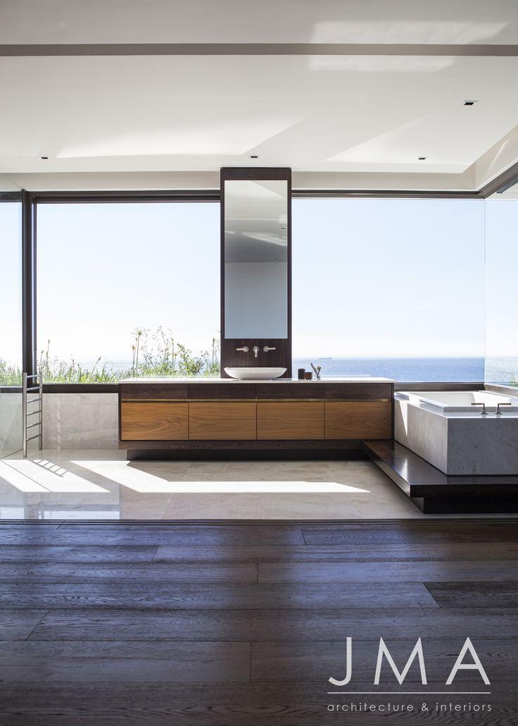 Ocean views from a large corner window in this en-suite bathroom.