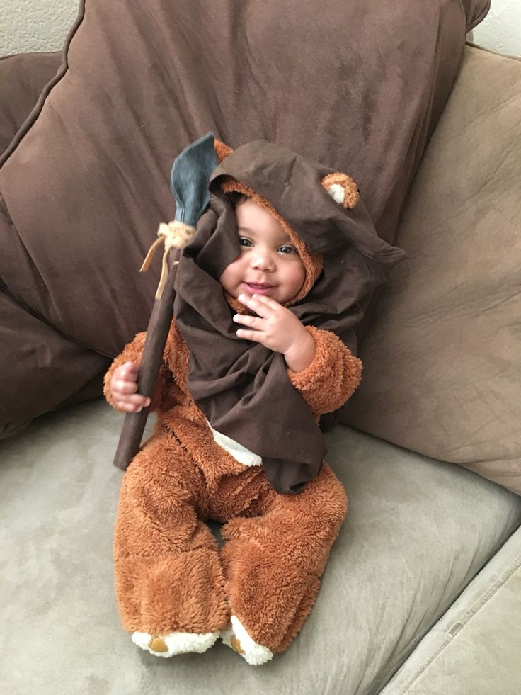 • bear costume  • brown t-shirt  • fabric glue • scissors   • spear made with felt and dowel