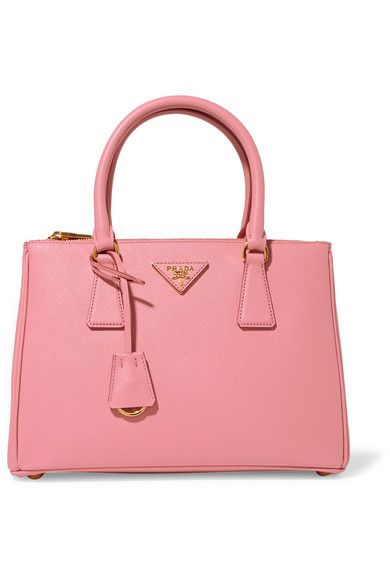 Prada updates its ladylike 'Galleria' bag in pretty petal-pink for Spring '17. Made in Italy from textured-leather, this feminine design has a structured silhouette and is organized into three jacquard-lined internal compartments. Carry it by the top handles or attach the optional shoulder strap.