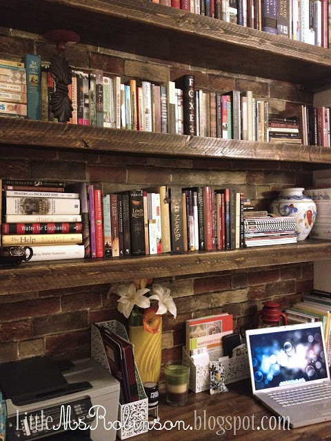 I want those shelves! And that brick wall, and everything!