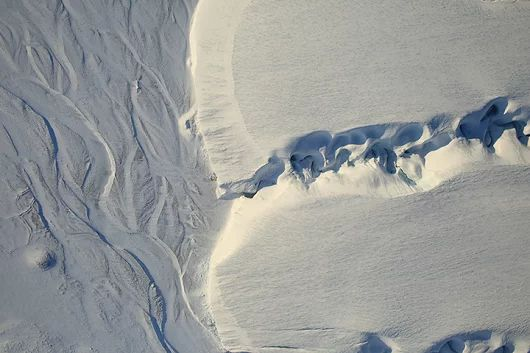 This is awesome. Meanders in a melt water stream on top of a glacier. Click t...