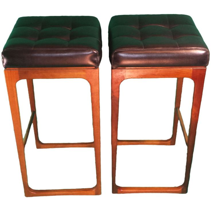 Pair of Gerald Easden sleigh leg bar stools. Wood and leather with brass foot rest. A great example from an award winning Australian Mid Century designer.