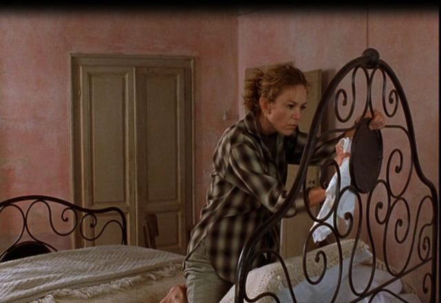 image of under the tuscan suns wrought iron bed with mary's image | Tour Bramasole in the Movie Under the Tuscan Sun