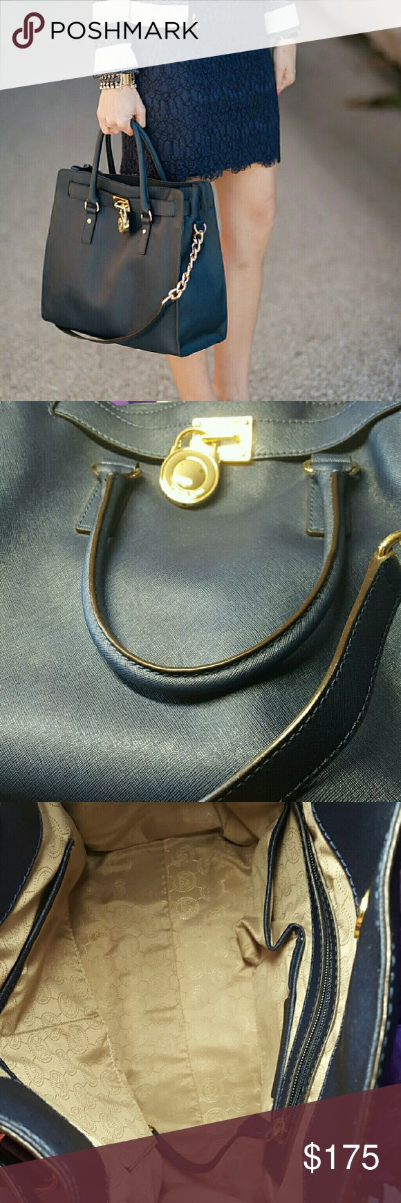 Michael Kors Navy Blue Hamilton bag Almost brand new. Used a few times. Gold hardware. Includes dust bag. Large size bag. Missing the dust bag. Bag is in almost perfect condition. Great deal. Michael Kors Bags