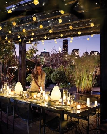This is just a beautiful reason why pergolas are so much fun....dining outdoors with simple lighting.....