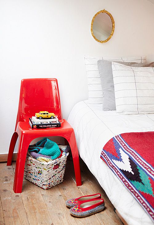 The red Perspex chair is an original Kartell chair from Italy, the throw on the bed is from a trip to Morocco