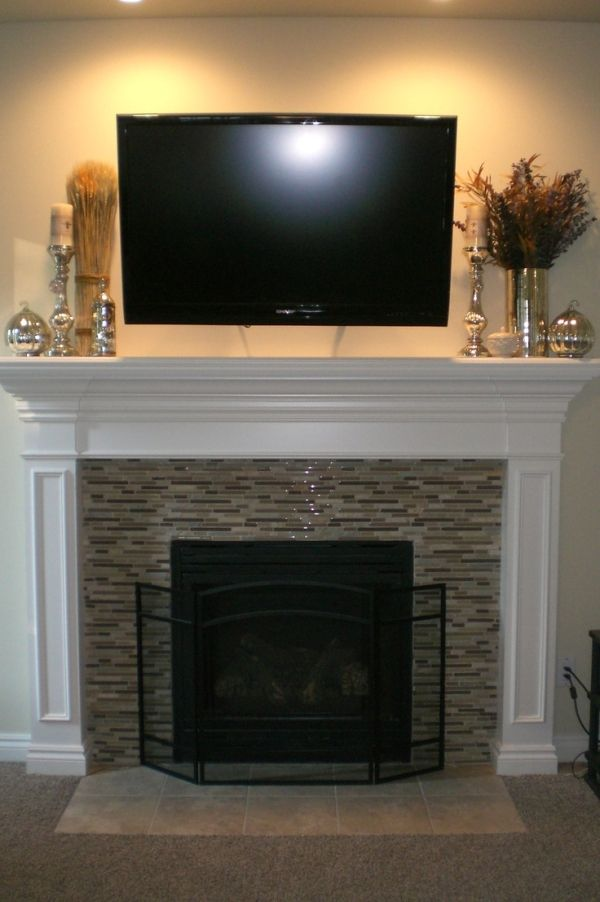 Gorgeous mosaic tile fireplace with white mantle. #decor #fireplace #tile #candles by clarissa