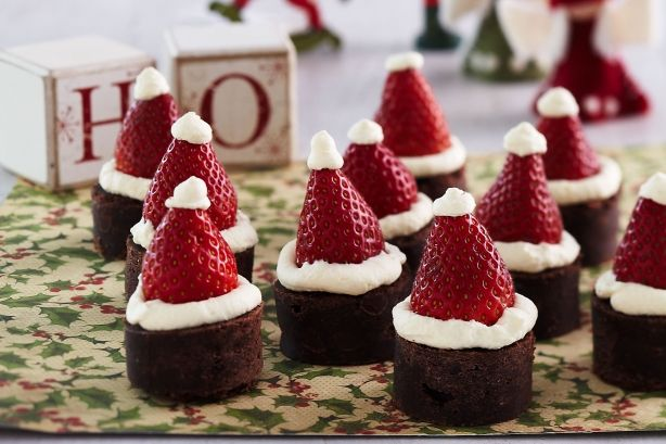 These bite-size choc brownies topped with strawberry Santa hats make for a fun and festive sweet treat.