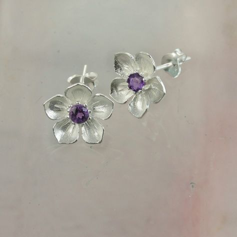 """Amethyst Posy Earrings £29.00 Very pretty little silver flower earrings set with natural amethyst stones All of our silver jewellery comes beautifully packaged in our new Christin Ranger branded boxes. Look for us in the September issue of """"Good Housekeeping""""."""
