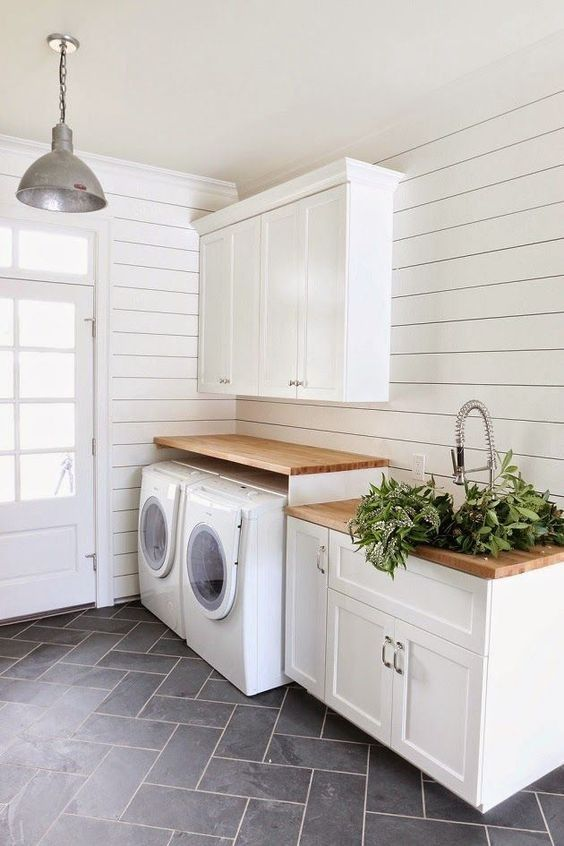Laundry room- love love love! wood work space above washer and dryer. We could do this with a hinge on one side to lift up when needed with top loading washer. Wood/white/farmhouse style