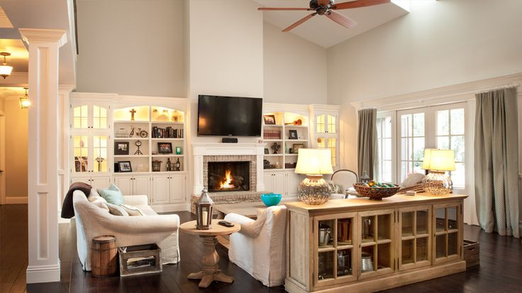 Open, two-story family room with white built-in ...