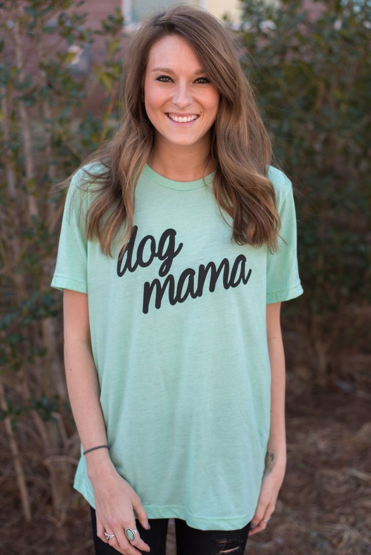 Dog mama script t-shirt mint. This trendy graphic t-shirt is part of our exclusive collaboration with a local vendor on a line we call Say What?! Every proud dog mom needs this! Unisex fit. 50% polyes