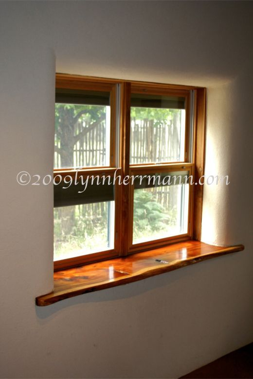Window in a straw bale home--look at that  window sill! #wood