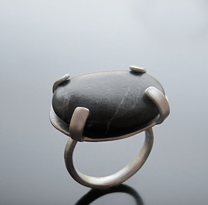 Maria Apostolou  |  A black pebble with grey veins, set in sterling silver.