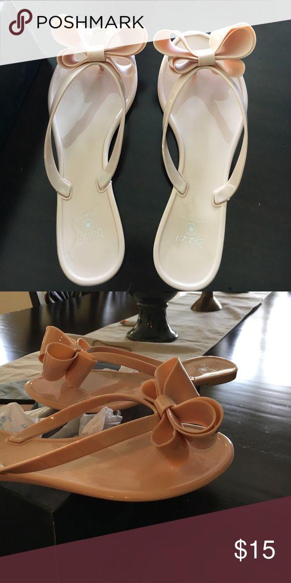 Blush pink bow flip flops🎀 Brand new! Perfect jelly flip flop! Blush color & super comfy! Dizzy Shoes Sandals