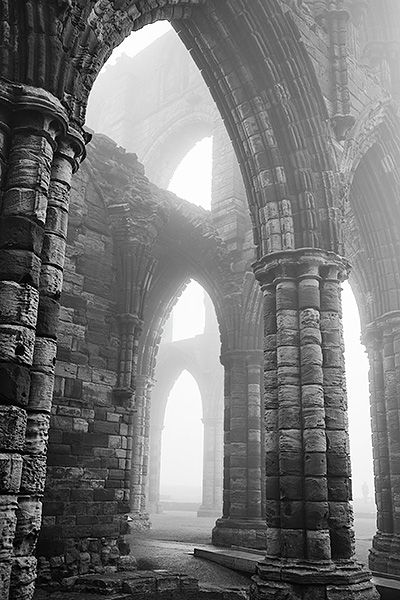 Whitby Abbey Arches (Whitby Abbey is a ruined Benedictine abbey overlooking the North Sea on the East Cliff above Whitby in North Yorkshire, England. It was disestablished during the Dissolution of the Monasteries under the auspices of Henry VIII.)