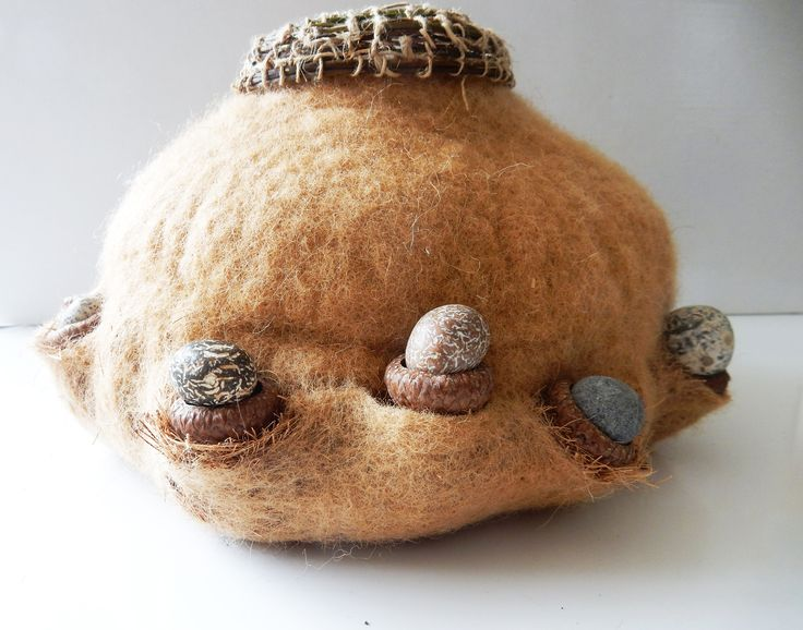 Wet felted vessel with coconut  fibers, acornheads and woven hedge bindweed. Round stones I picked from Brighton beach during the sun eclipse . Summer 2015. Gea Andriessen. Facebook.com/degroeneuil