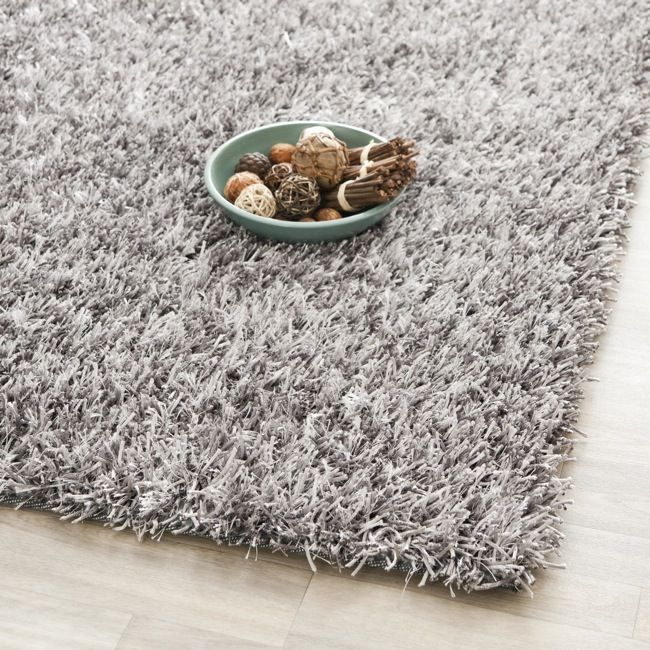 This handcrafted grey shag rug brings luxurious comfort and classic styling with a richly textured pile that will cushion your feet and draw praise from visitors to your living space. The durable canvas backing will ensure a long life of use.