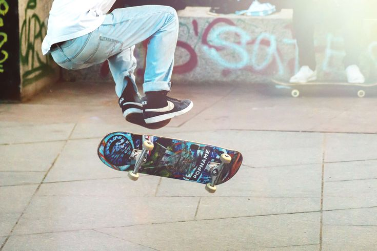 #action #adult #board #boy #city #deck #fun #graffiti #guy #jump #man #motion #outdoors #pavement #person #road #shoes #skate #skateboard #skateboarding #skater #sneakers #sport #street #urban #wear #wheels
