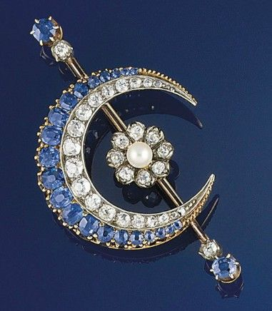 A late 19th century sapphire, diamond and pearl brooch  Of crescent design with graduated old brilliant-cut diamonds oval sapphires to a knife edge bar with central pearl and diamond flowerhead and sapphire and diamond two stone terminals, mounted in silver and gold, circa 1890
