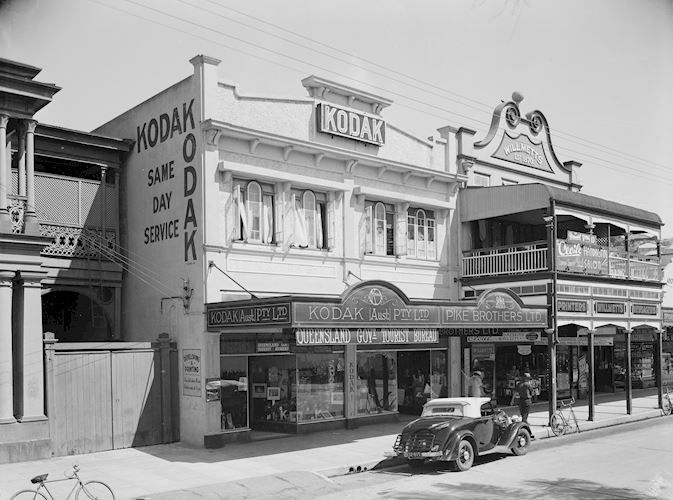 Black and white film negative of the Kodak Australasia Pty Ltd branch store and same day processing laboratory on Flinders St, Townsville, Queensland, in the 1930s.  Townsville, QLD, 1930s