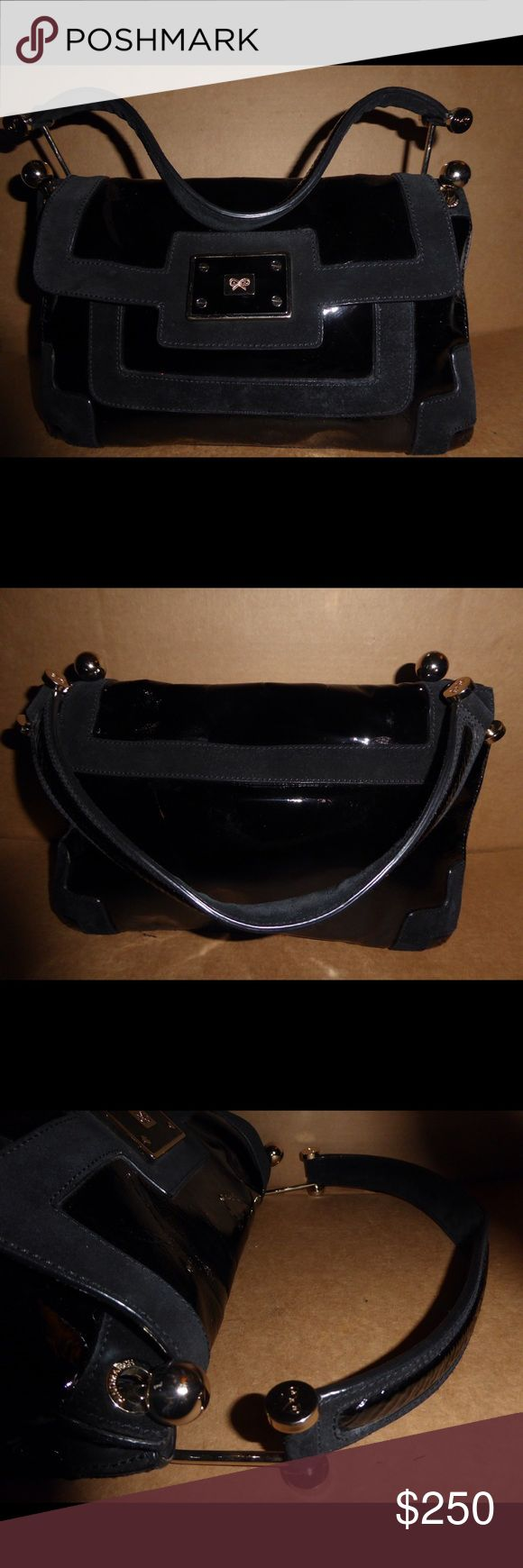Authentic Anya Hindmarch purse Gently use and it's in good condition Anya Hindmarch Bags Hobos
