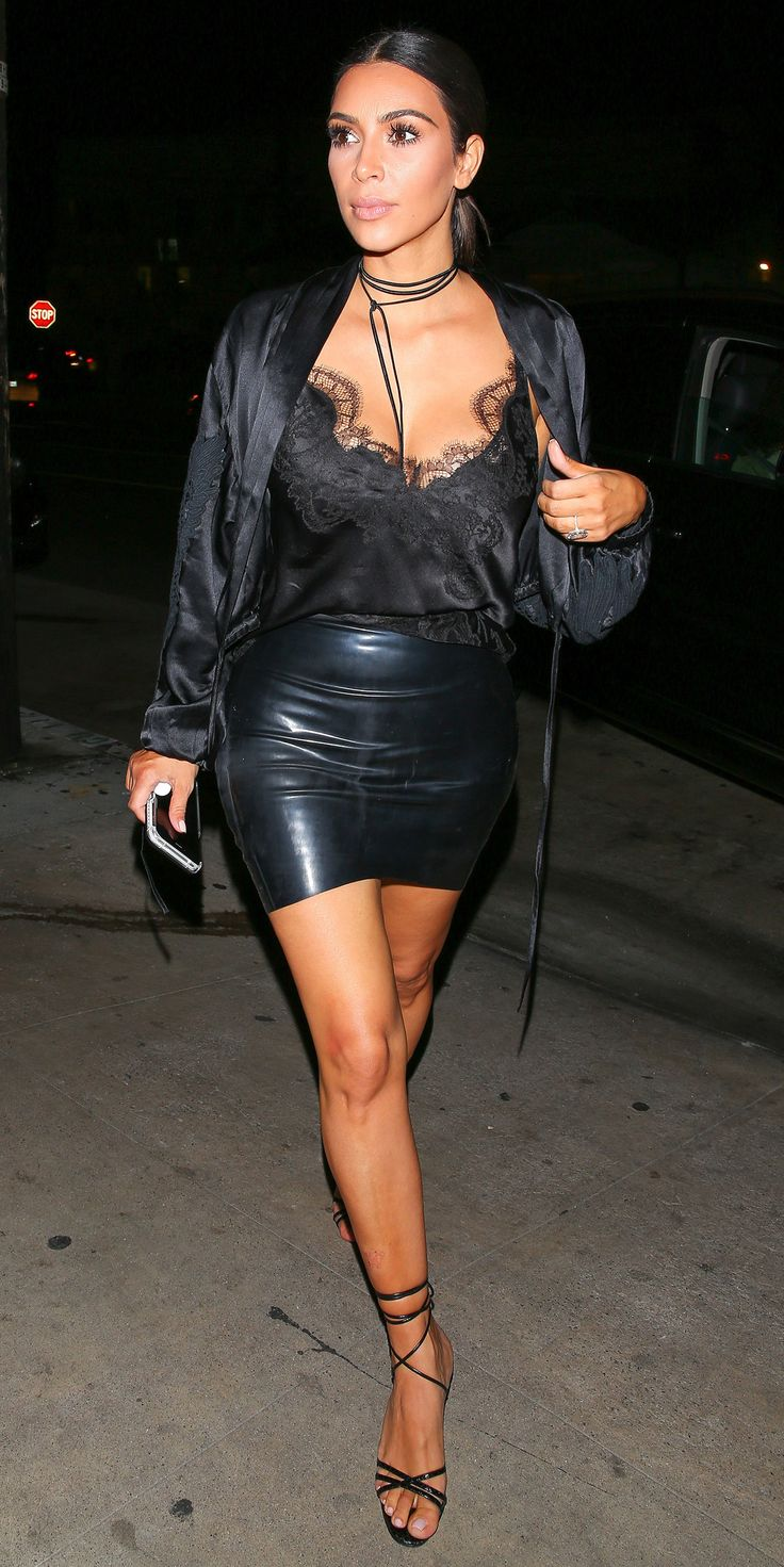For a night out, Kim Kardashian brought boudoir dressing from the bedroom out onto the streets with a lace-trimmed satin cami tucked into the littlest black leather mini, complete with a satiny robe-style jacket, a shoelace-string choker, and delicate strappy sandals.