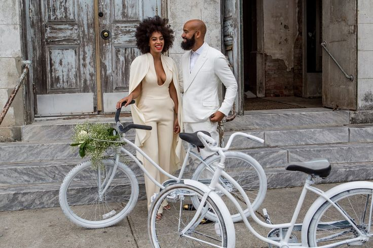 Solange on her weddding day with beautiful white bicycles. What a lovely idea! via velondonista.com