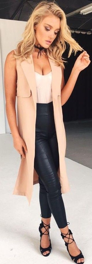 Camel Vest + White Top + Black Leather Pants                                                                             Source