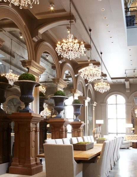 Palatial dining room with 3 chandeliers suspended over a table that seats 20 persons!