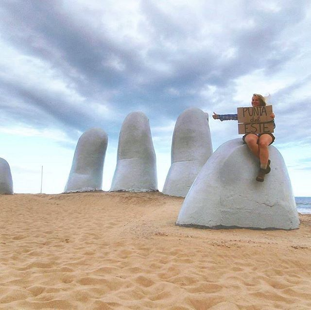 """Know any underrated landmarks? Tell me about them! This is the ""Hand from the sand/Los Dedos"" 👋 Uruguay's most famous landmark! 😉 not exactly the eiffel tower, but much more interesting anyway... wanna read more about where it's at and how Punta del Este is like? I wrote a story about it!"" Awesome capture by Iris @irisveldwijk 💙 📸 #globalstorybook"