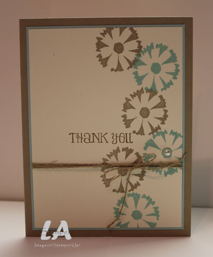 Brown and teal are a great color combo on this handmade thank you card.  The flower stamp on the front alternates the colors, and a tiny trim of teal peaks out behind the cream-colored front panel.  A wrapped bow of twine and one pearl button are all you need to finish the card.