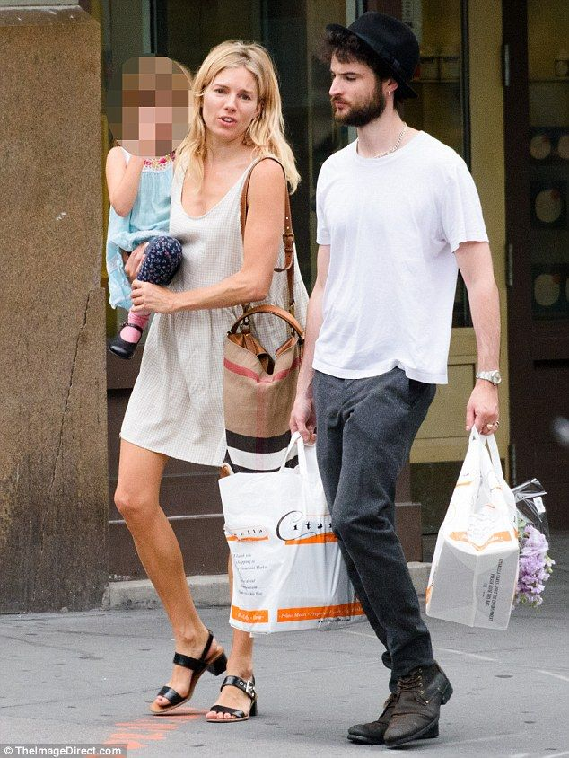 Friendly former flames: on Tuesday Sienna Miller and Tom Sturridge looked to be as cordial as ever when they stepped out with their daughter Marlowe in New York