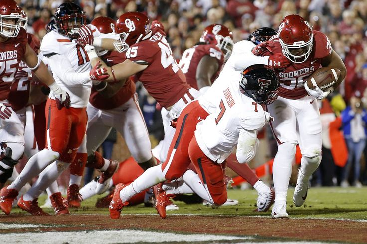Oklahoma\'s Dimitri Flowers (36) scores a touchdown beside Texas Tech\'s Jah\'Shawn Johnson (7) during a college football game between the Oklahoma Sooners (OU) and the University of Texas Tech Red Raiders (TTU) at Gaylord Family-Oklahoma Memorial Stadium in Norman, Okla., Saturday, Oct. 28, 2017. Photo by Bryan Terry, The Oklahoman