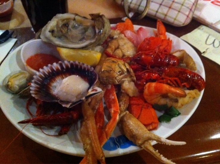 Village Seafood Buffet - Las Vegas, NV, United States. Plate #1 - oysters, scallops, clams, crawfish, mini lobster tails, prawn, hot & cold crab legs, sashimi, etc.