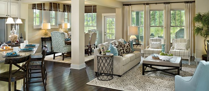 Freshen Up Your Décor - David Weekley Homes | open floorplan decorating idea.  The furniture doesn't all match but the style and color scheme flows in this space.