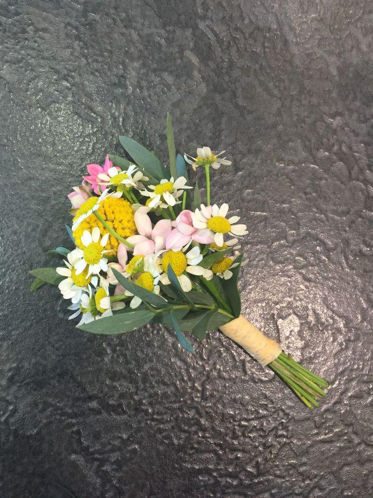 Boutonniere: Craspedia, Mini Daisies, Cerise Pink Bourvardia, Eucalyptus Parvi, neatly tied with raffia detail.