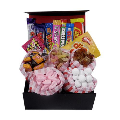 A #hamper full of sweet treats for the Summer holidays that you might not want to share with the kids! This hamper is full of retro sweets including cola bottles, pink shrimps, sour tongues, black jacks, fruit salads, bon bons, wham bars, refresher bars and more. Enjoy this hamper to keep you going during the Summer holidays!
