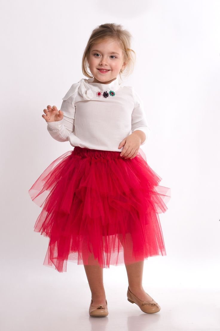 Red soft tulle ruffled skirt and white blouse in fine veil and with swarovki and glass bids embroidery, together in a beautiful outfit from Designers for Kids. Designer children clothes inspired from fairytales and suitable for urban princesses.