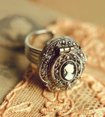 Cameo ring with a hidden compartment for a pill. We had this one and one with a purple jewel.