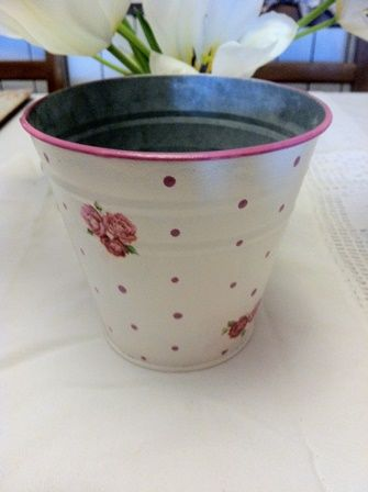 Dots and roses. Pretty tin planter.