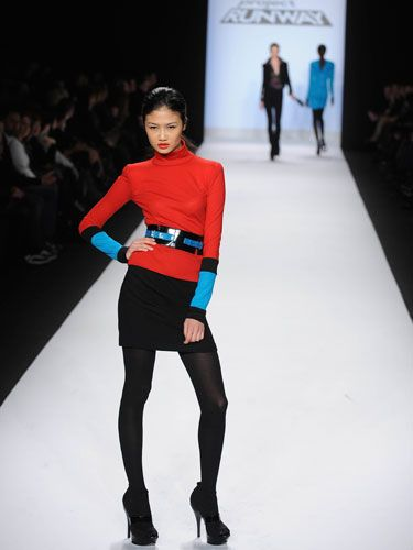"""Designer: Emilio Sosa Despite the vivid use of color, judge Michael Kors wished Emilio had """"turned the notch up a touch."""""""