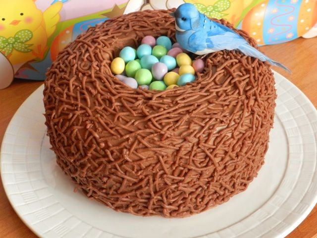 """Easter Bird Nest Cake, Adorable & very easy to create. This is made with Chocolate Buttercream Frosting, & also piped with a #4 tip, in small lengths, different directions to create the """"Nest"""" look..."""