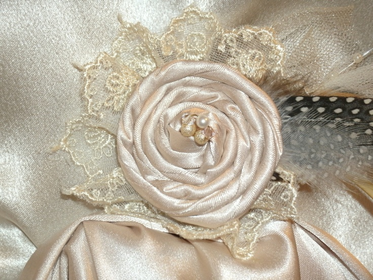 """Made with twisted fabric, lace and feathers on a """"Guber"""" adhesive Dot"""