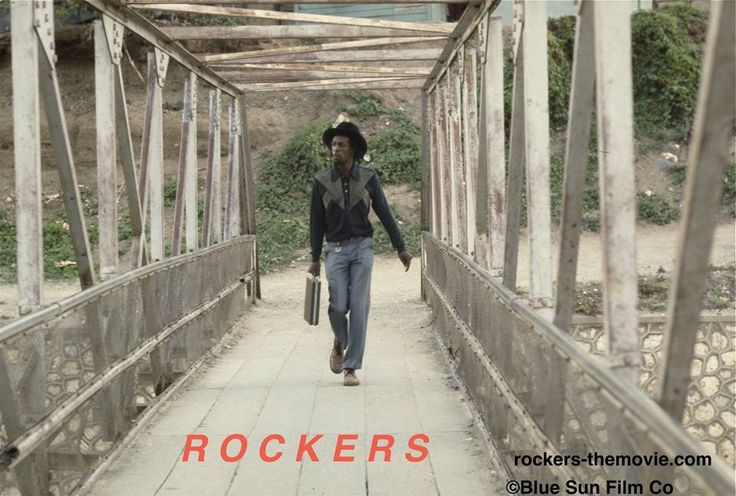 "GREGORY ""JAH TOOTH"" ISAACS IN A SCREENSHOT FROM ""ROCKERS"""