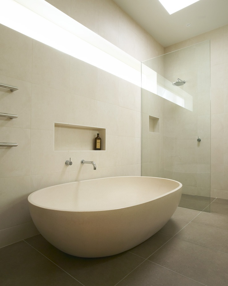 Surrounded by all white wall tiles and offset by the subtle grey of the floor,    Apaiser's 'Haven' bath becomes the aesthetic anchor in this is contemporary bathroom. Created in reconstituted eco stone and finished to the highest standard, Apaiser's bath ware fittings are at the foremost point of design.